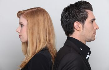 profiles of a young woman and man